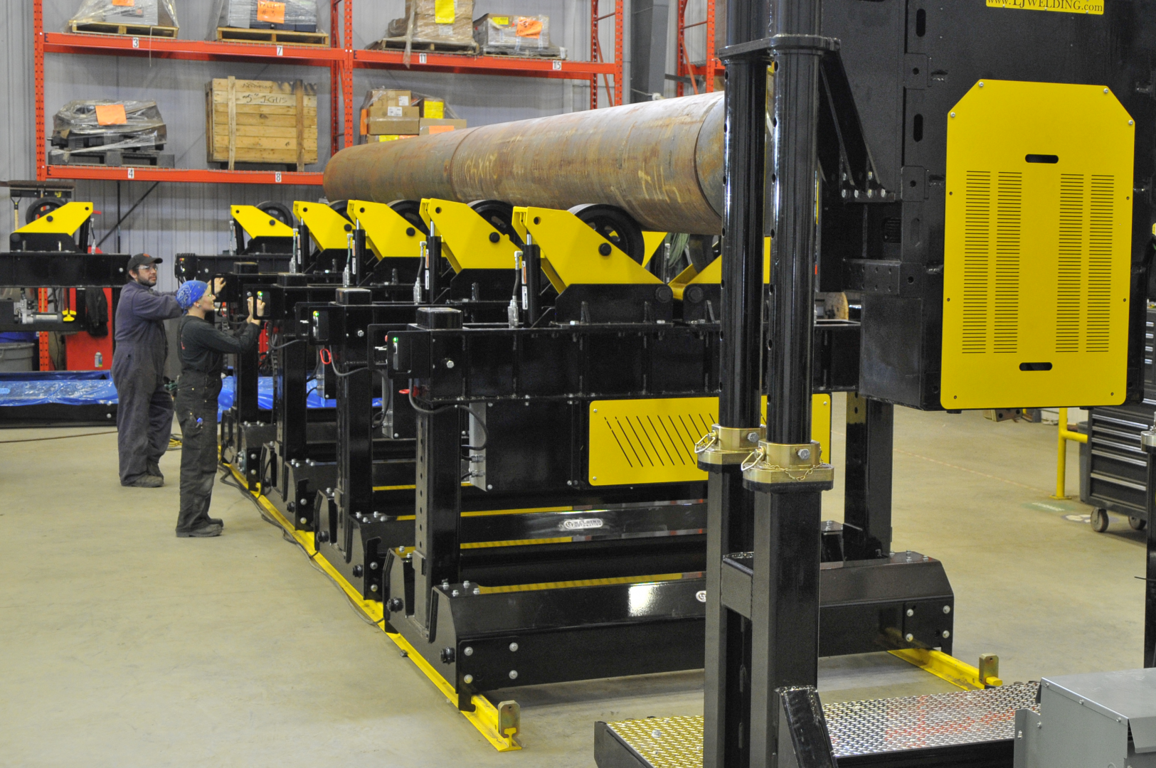 pipe and vessel material handling system for multi-purpose fabrication shops