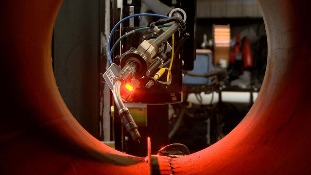 MIG welding manipulator weld head