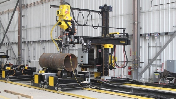 pipe double joining turning roll system with a welding manipulator