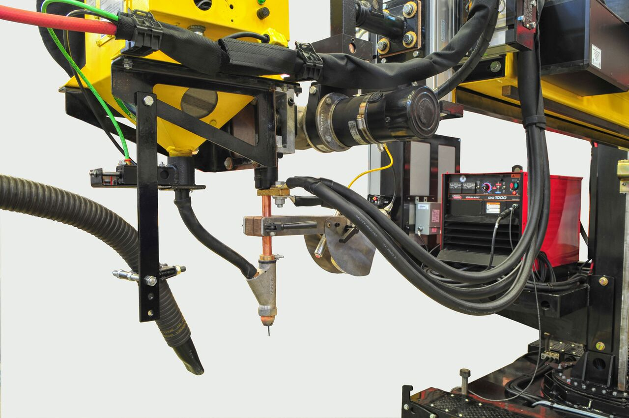 flux feed and recovery systems for welding manipulators