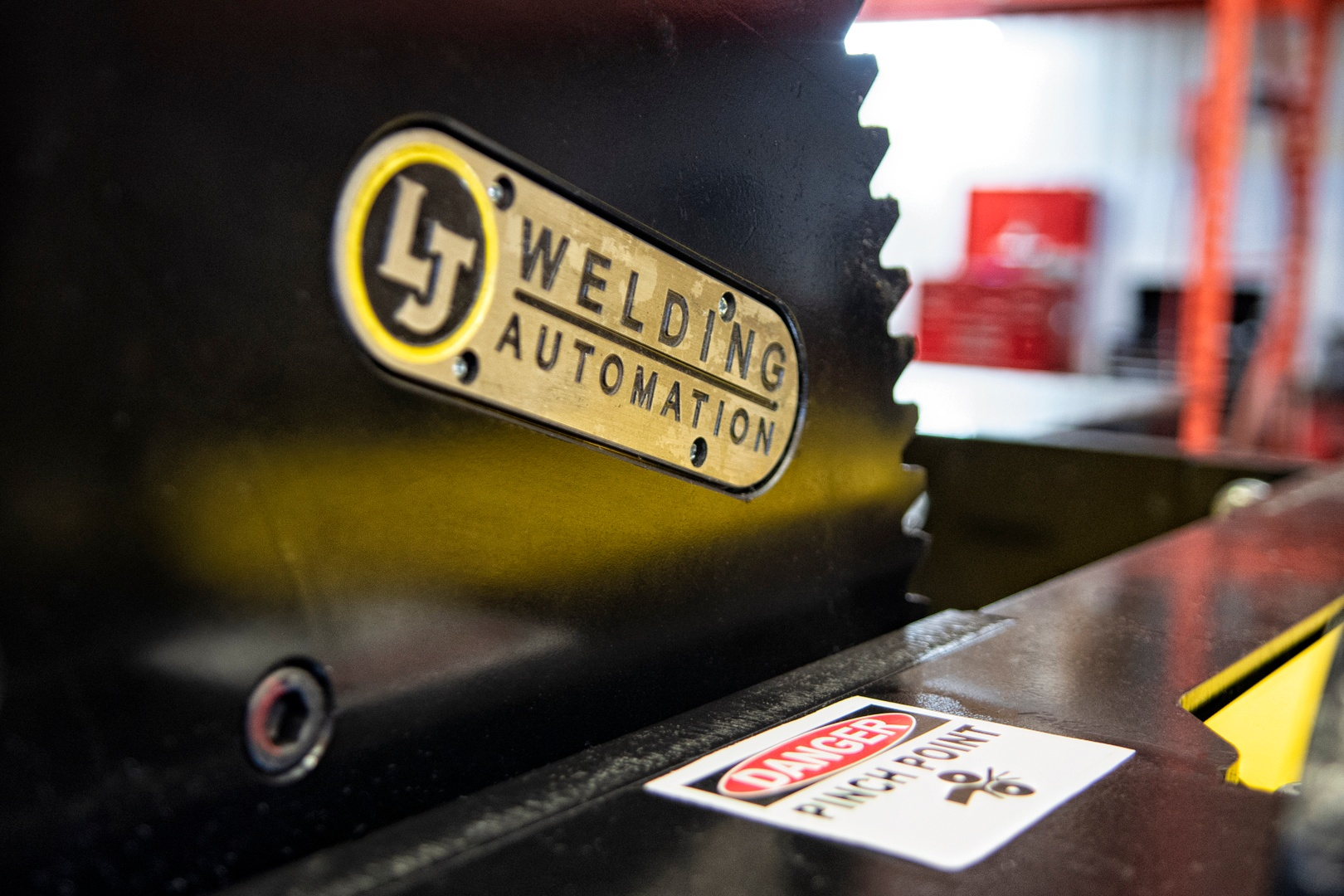 close up of lj welding logo on the gear tilt positioner