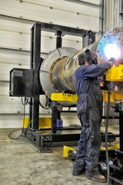 headstock positioner and pipe stands with man welding