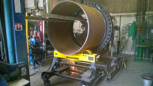 heavy-duty pipe welding stand in mid weld