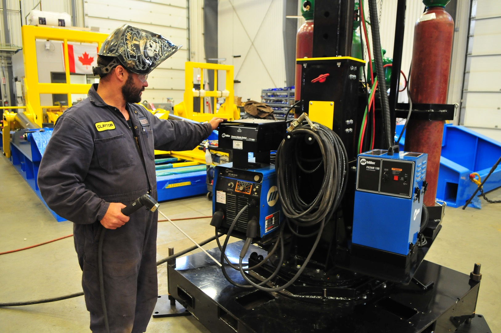 MIG welding boom mount with welder