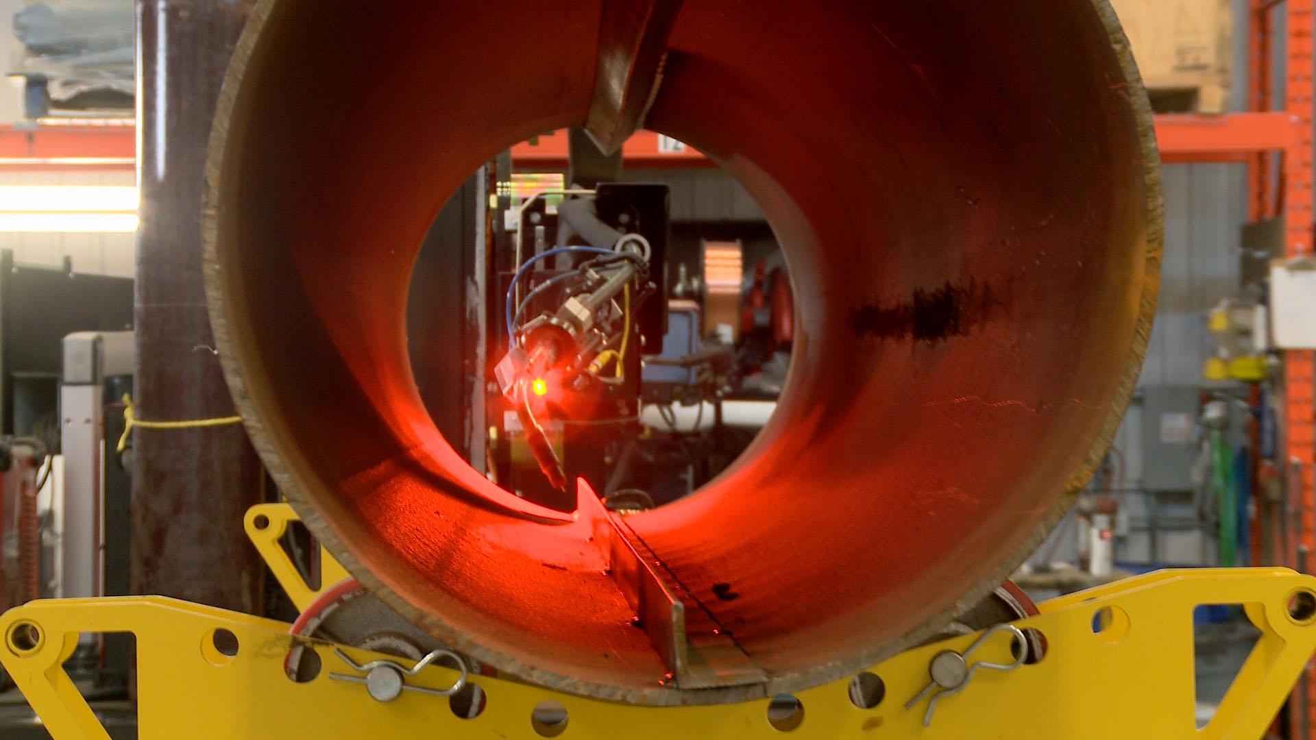 laser seam tracking on a column and boom manipulator.