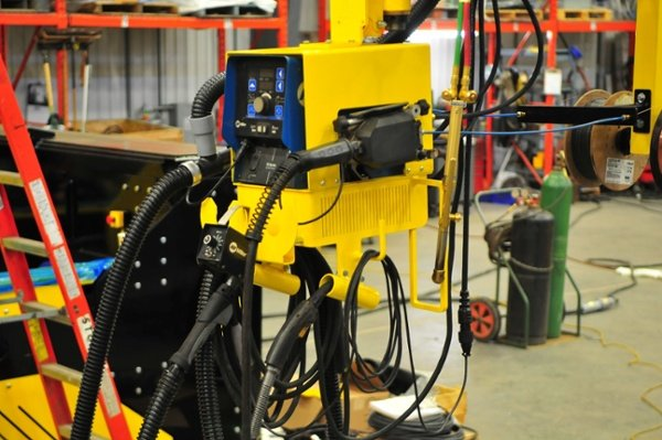 MIG welding boom mount power source