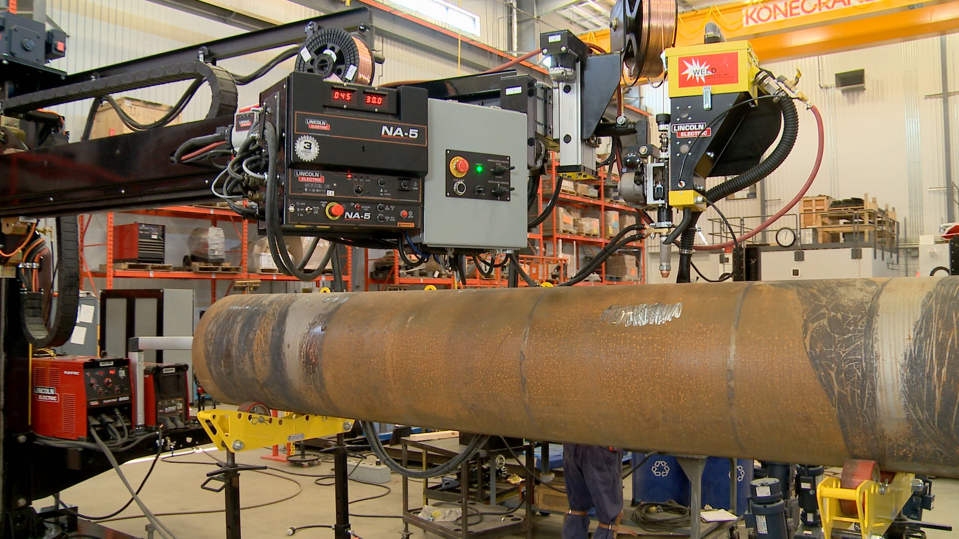 welding boom manipulator controls with roller pipe stands