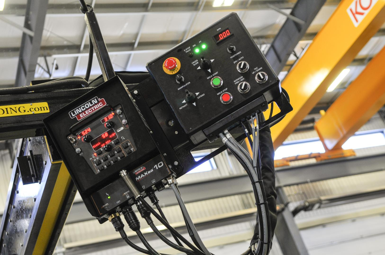 close up of lincoln boom mounted controls for CaB welding system.